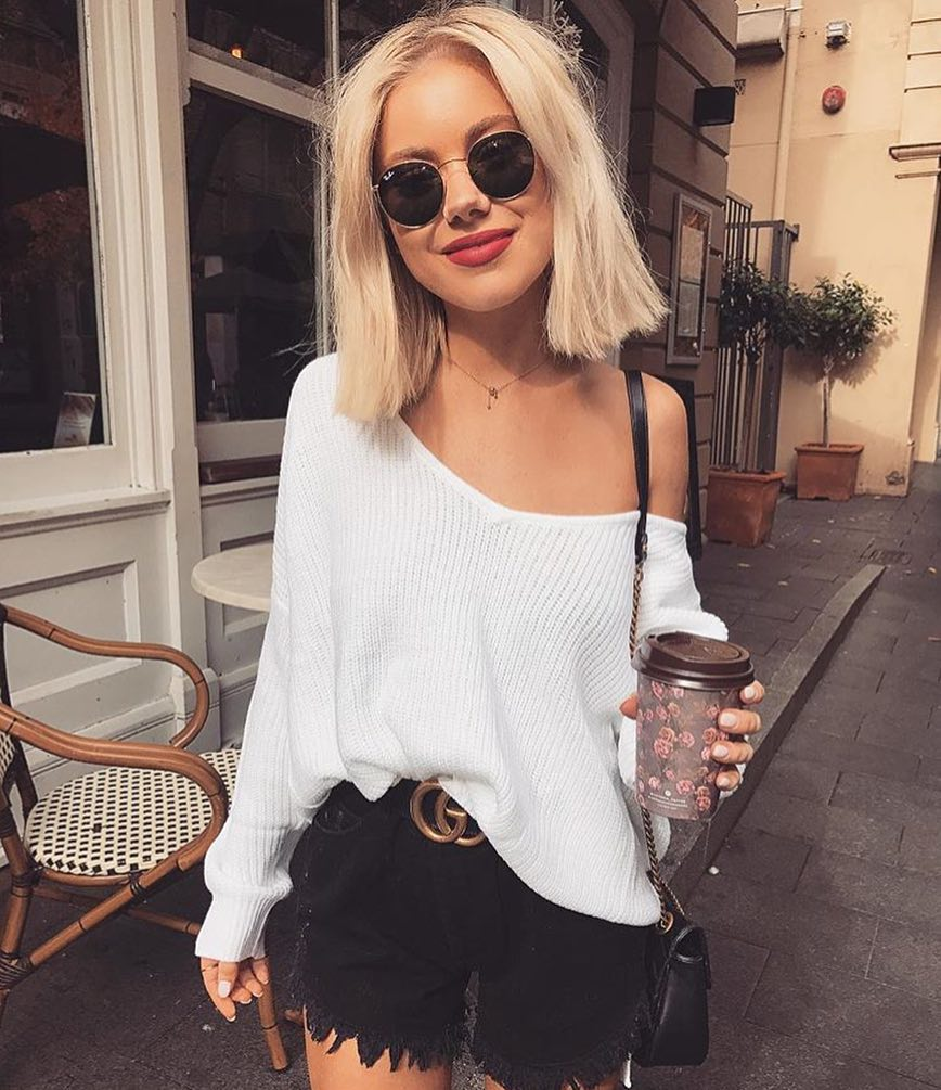 One Shoulder Slouchy White Sweater And Black Denim Shorts For Summer 2021