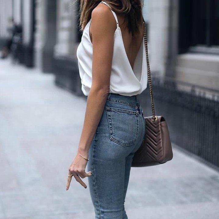 Open Back White Slip Tank Top Tucked in Blue Skinny Jeans For Summer 2020