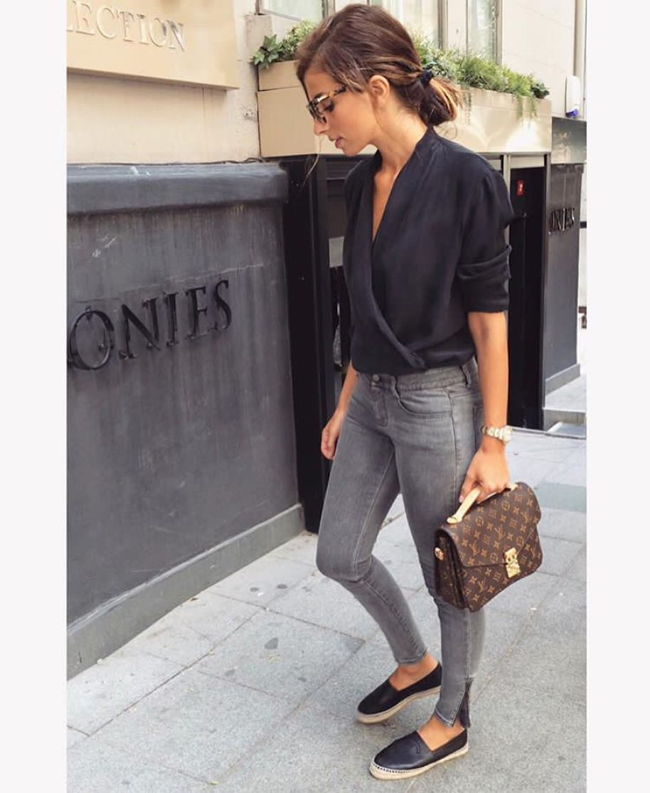 Black Wrap Silken Blouse Tucked In Grey Skinny Jeans For Summer 2019