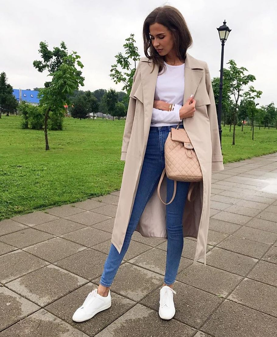 Beige Tailored Coat, White Top, Blue Jeans And White Kicks For Spring Months 2019