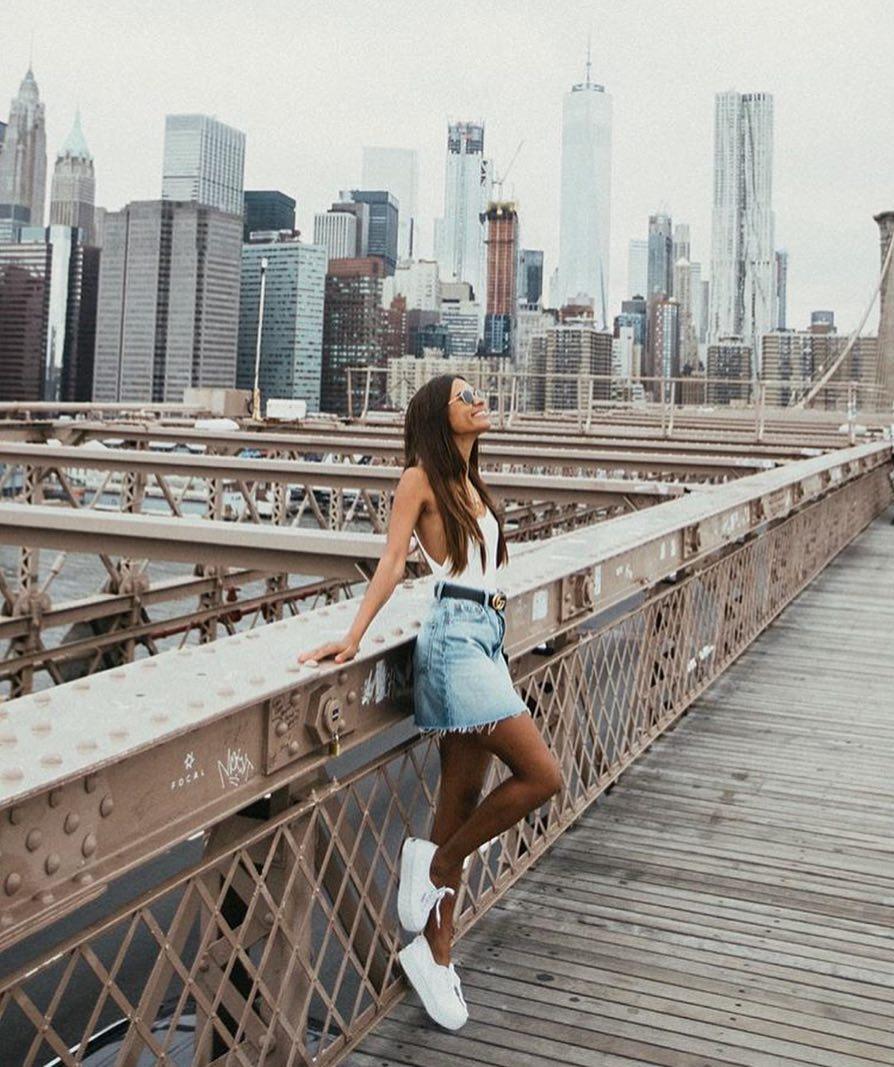 White Bodysuit And Denim Skirt With White Sneakers For Street Walks 2020