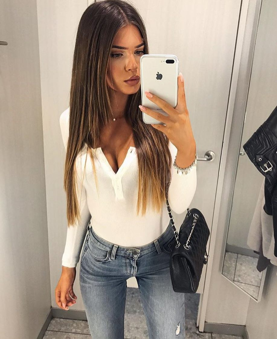 White Bodysuit With Long Sleeve Tucked In Wash Grey Skinny Jeans For Summer 2020