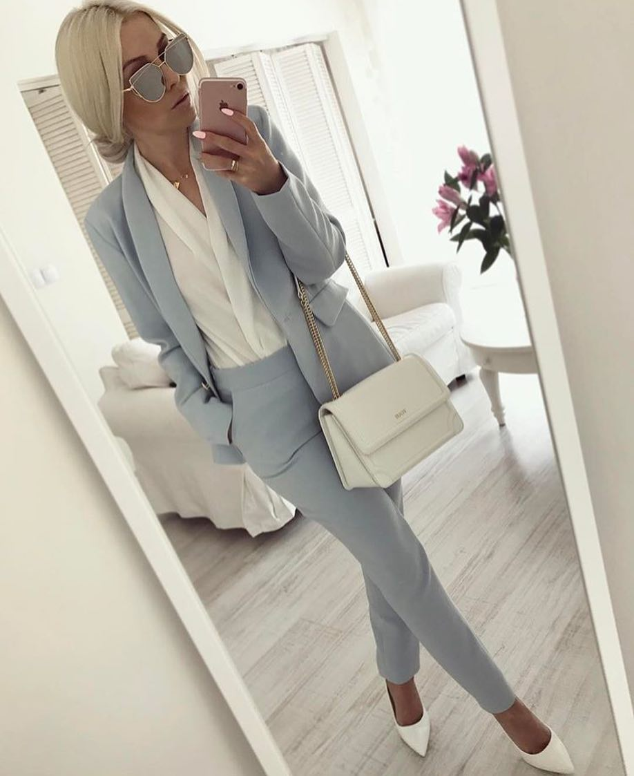 Pastel Grey Pantsuit With White Wrap Blouse And White Pumps For Spring 2020