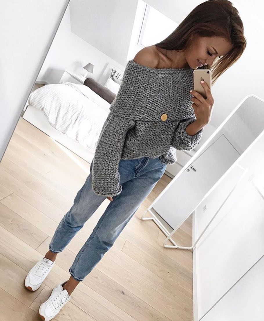 Grey Off Shoulder Chunky Knit Sweater With Blue Jeans And White Kicks For Spring 2020