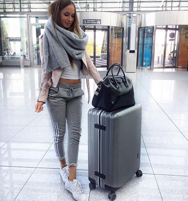 Sports Casual Airport Outfit Idea: Pink Biker Jacket, Grey Joggers And White Kicks 2020