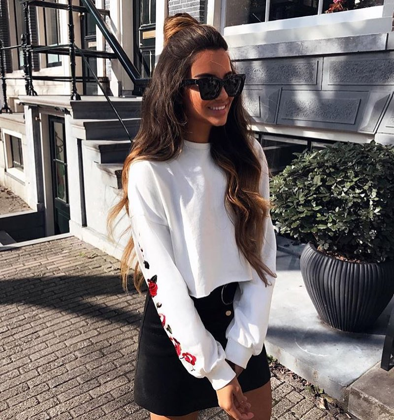 Shortened Sweater In White With Black Suede Skirt And Oversized Sunglasses 2020