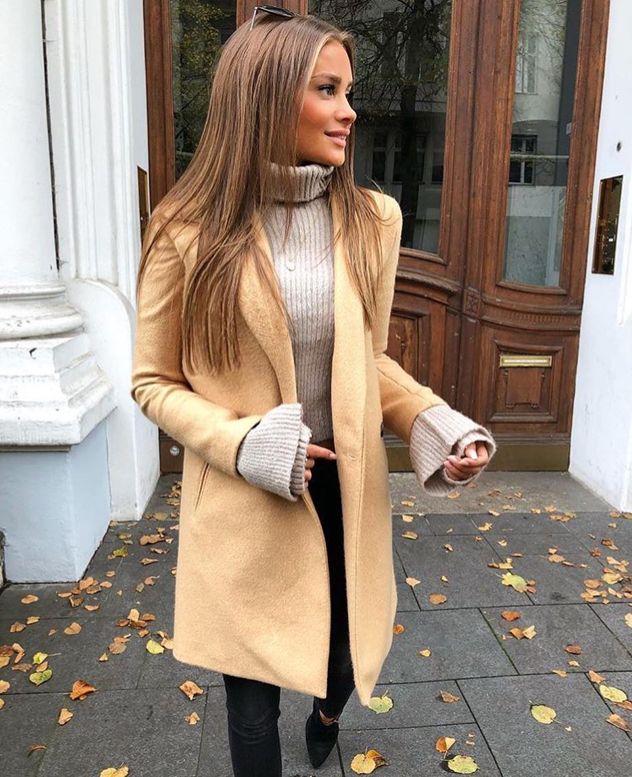 Light Camel Coat Over Ribbed Knit Turtleneck Teamed With Black Skinnies 2020