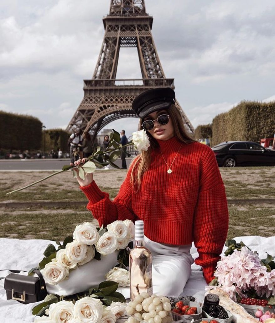 Parisian Chic Fall Outfit: Red Sweater, White Jeans And Black Driver Cap 2021