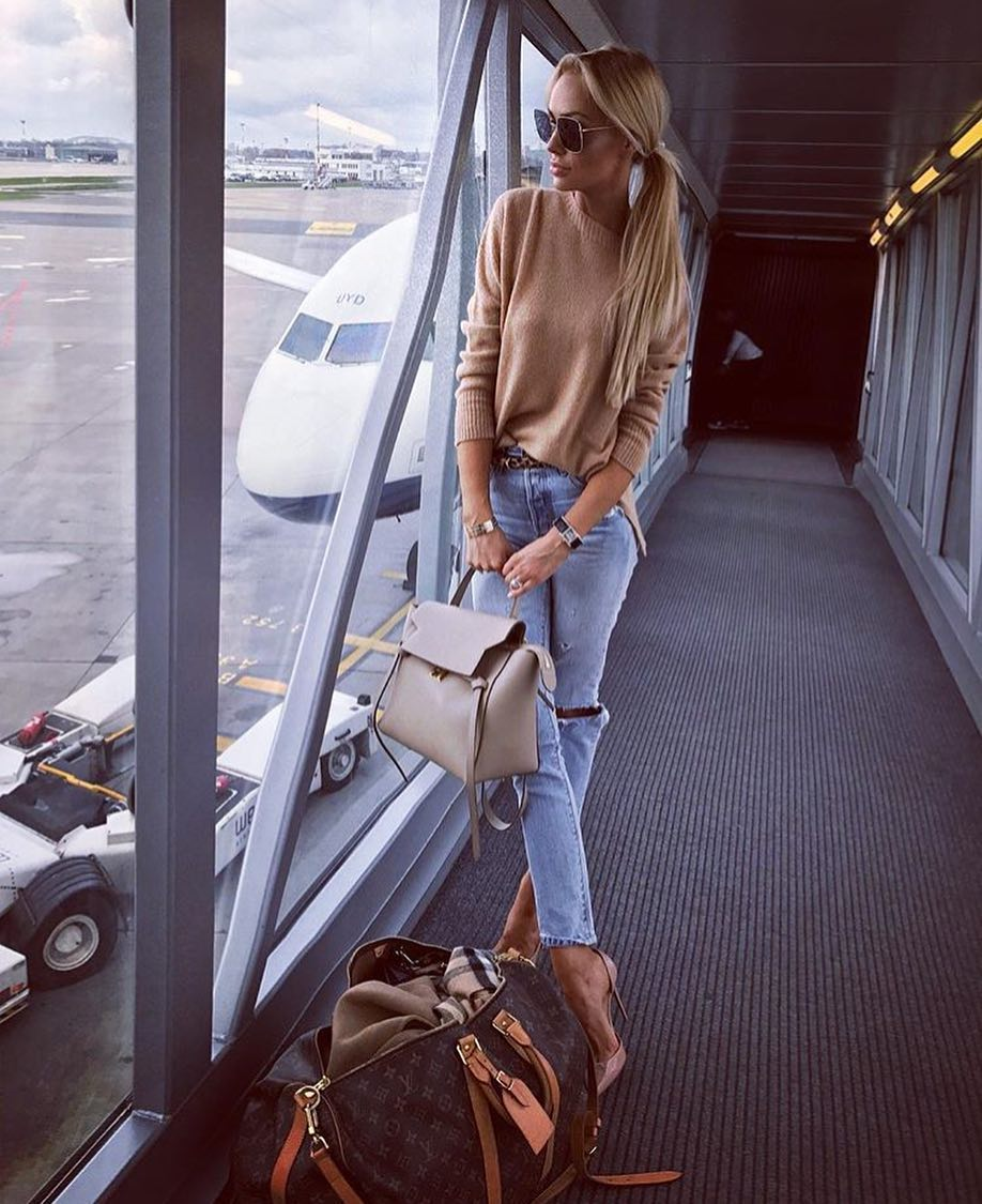 89100e8be2 Simple Airport Outfit Idea  Camel Sweater And Ripped Jeans With Nude Pumps  2019