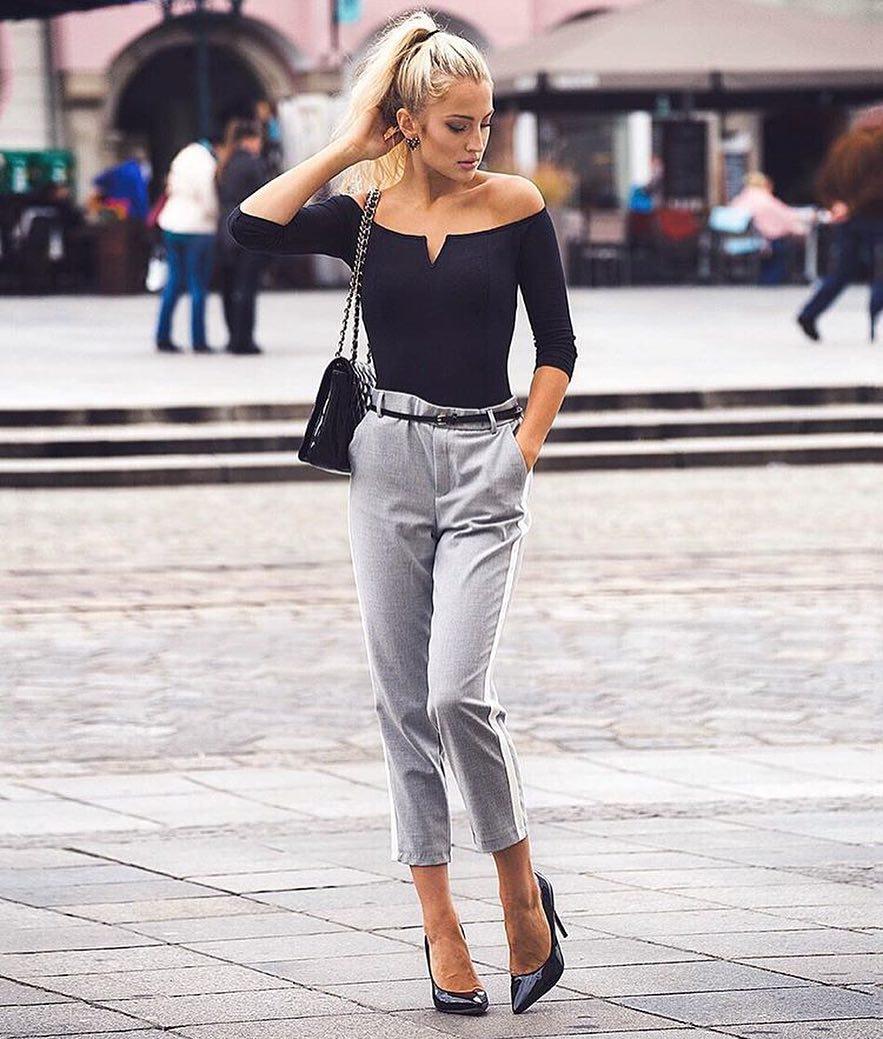 Off Shoulder V Cut Bodysuit In Black Teamed With Grey Tailored Pants For Spring 2019