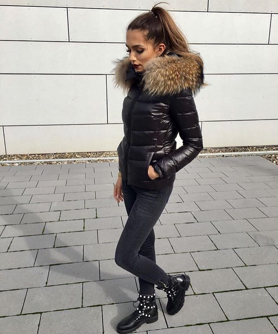 Down Jacket With Fur Collar And Skinny Black Jeans Tucked In Pearled Boots 2019