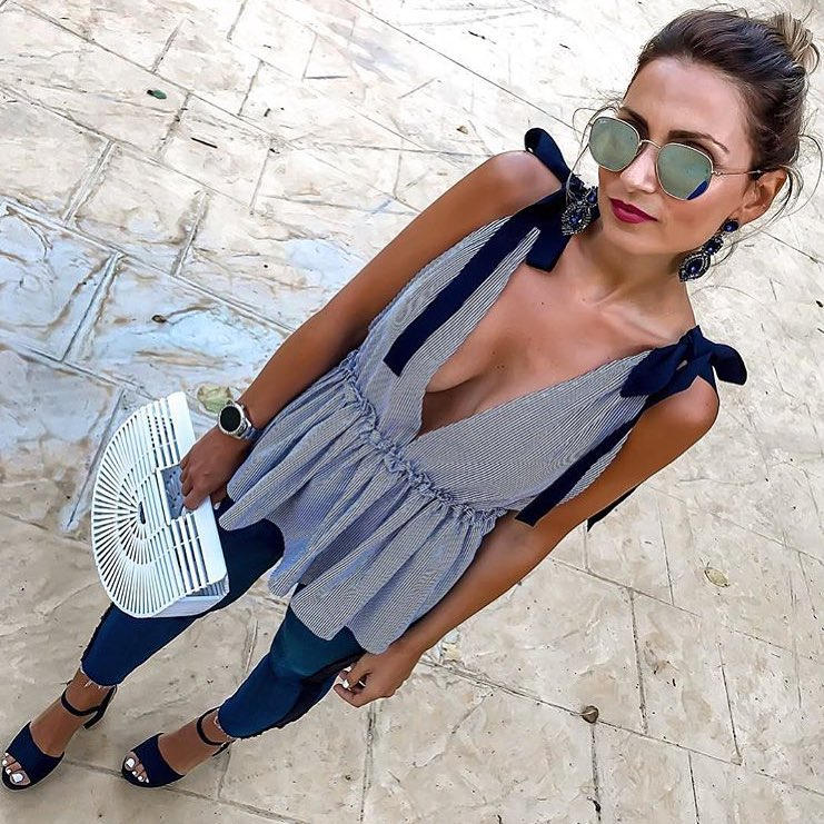 Deep V-Neck Peplum Blouse And Blue Skinny Jeans For Summer Vacation 2020