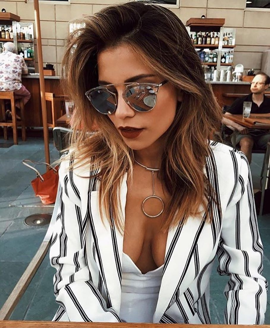 White Blazer In Stripes With White Bodysuit And Mirrored Rounded Sunglasses For Summer 2020