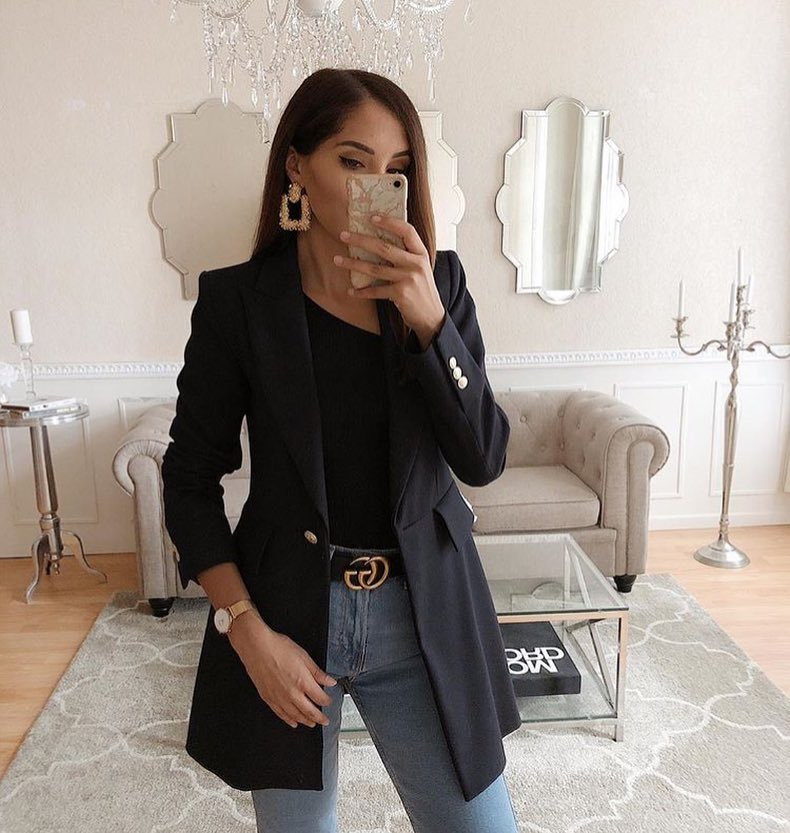 Black Blazer With Black Top And High Rise Blue Jeans For Spring 2020