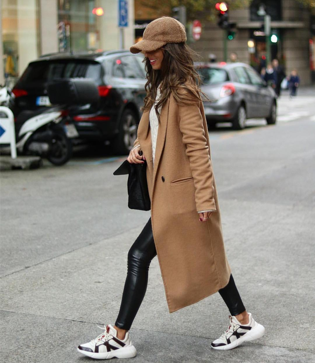 Camel Coat With Black Leather Pants And Chunky Sneakers In White For Fall 2019
